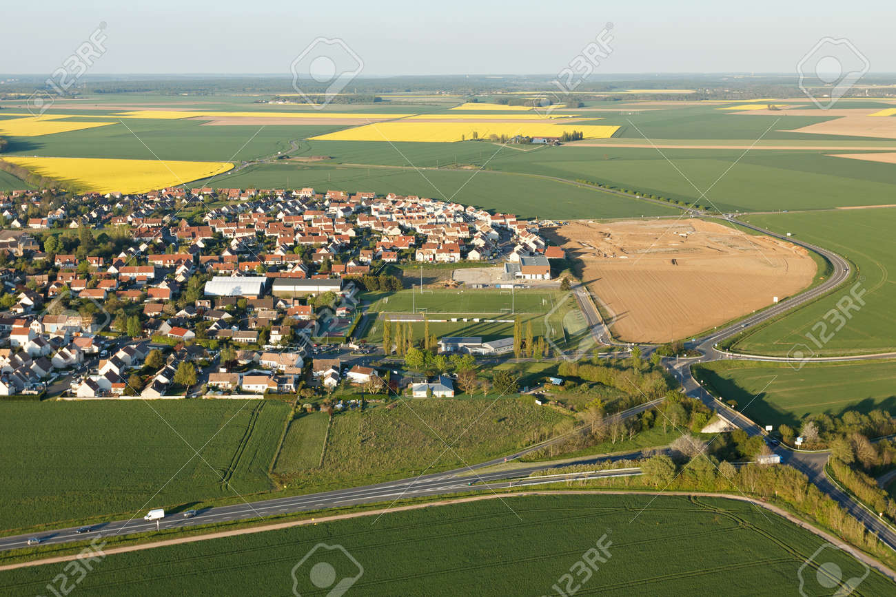 Aerial photograph of Ablis and rapeseed fields in spring, located in the south of the Yvelines department, ÃŽle-de-France region, France. - 166832605