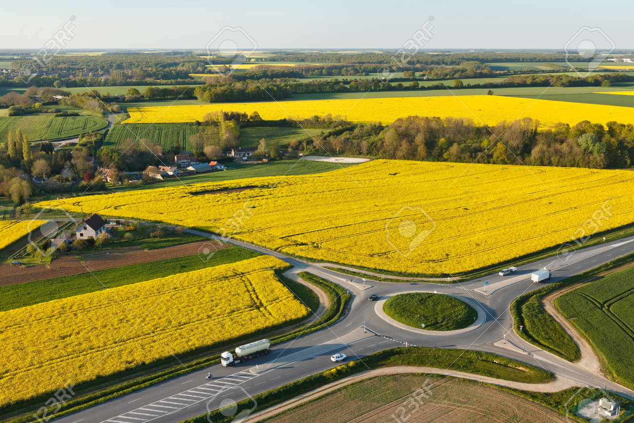 Aerial photograph roundabout and rapeseed in spring in Prunay-en-Yvelines, in the south of Yvelines department, in ÃŽle-de-France region, France. - 166832607