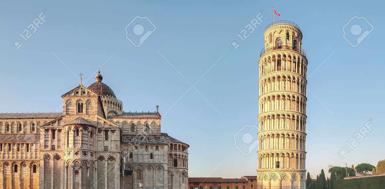 View of the cathedral and the bell tower (Leaning Tower of Pisa) in the city of Pisa, Italy. - 135202945