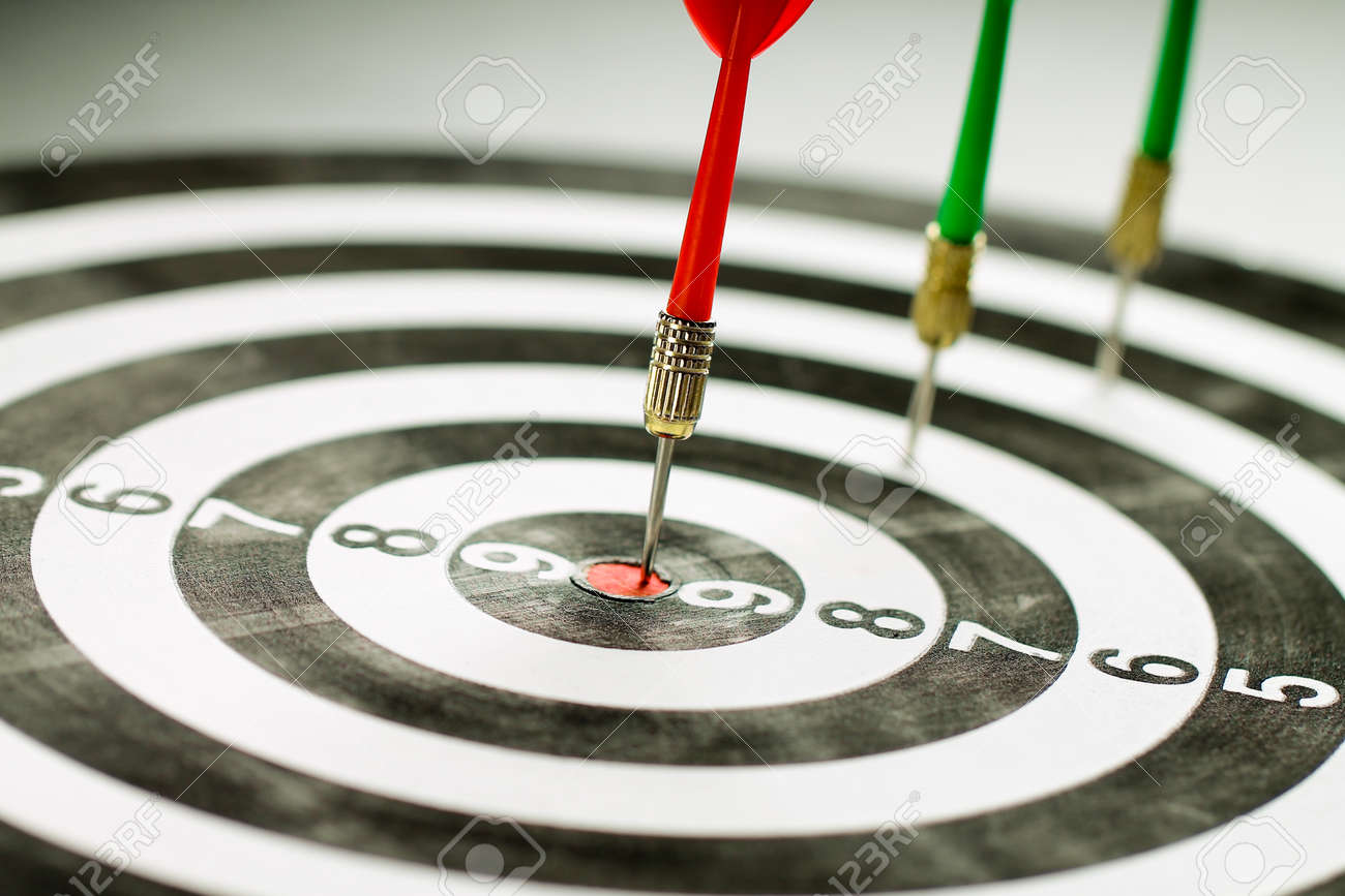 The red dart hits right on target. Winner. - 168834959