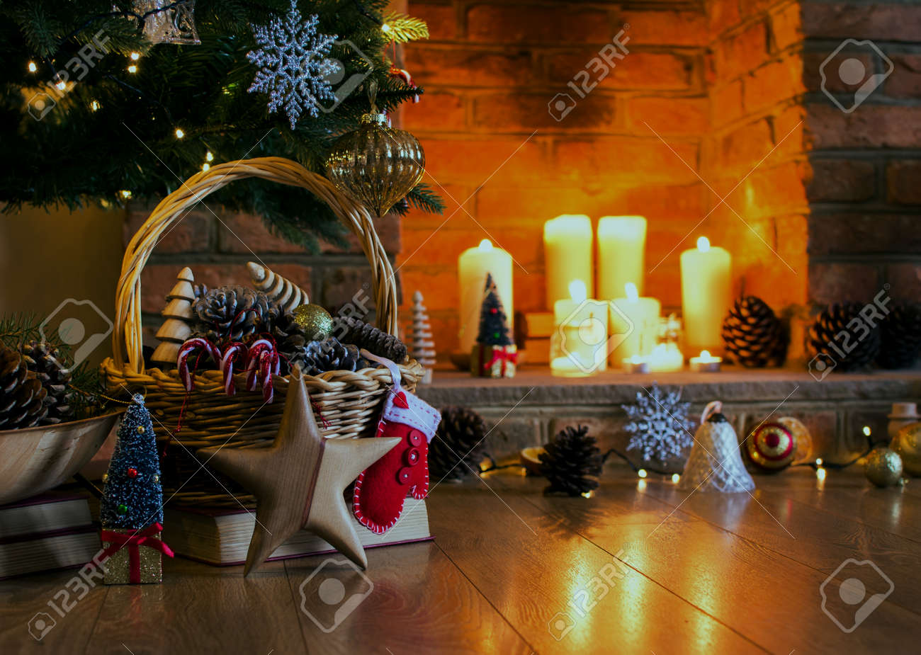 Christmas Decorations In The Basket In Front Of The Fireplace
