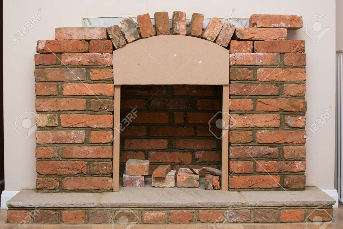 Indoor Diy Project Building Fireplace In The House Laying Bricks