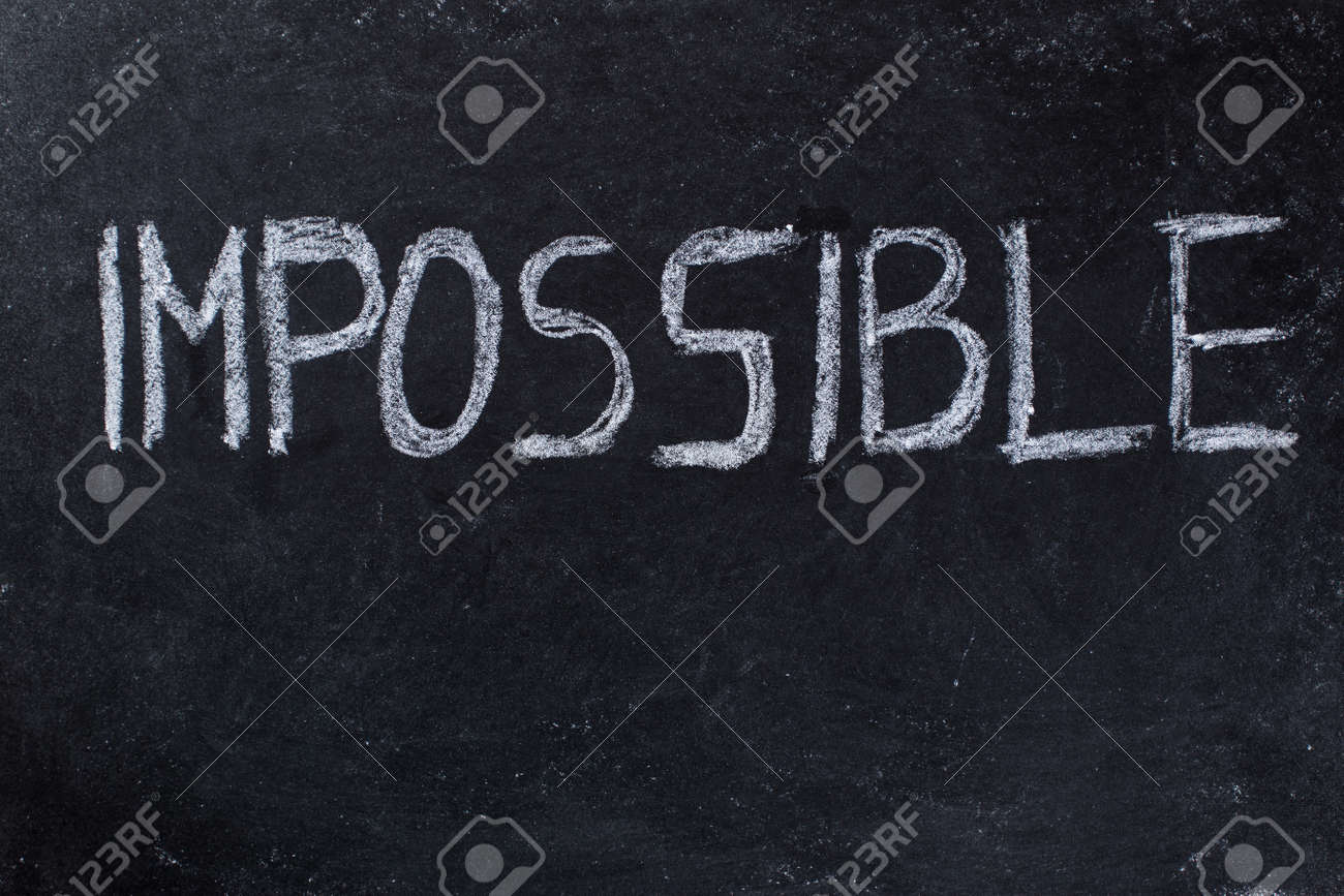 The Word Impossible Written On Black Chalkboard Background Stock