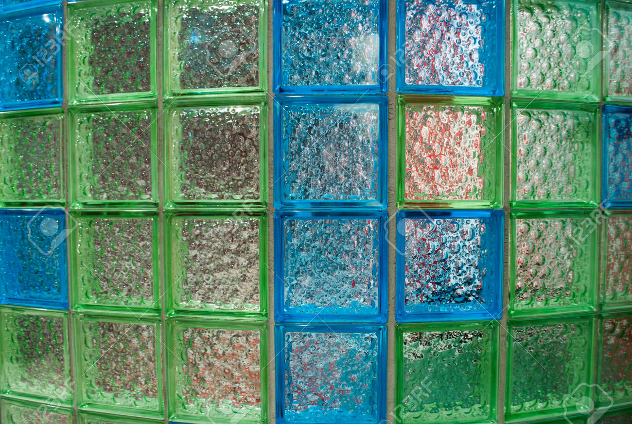 Semicircular Wall Made Of Aquamarine And Green Glass Tiles In