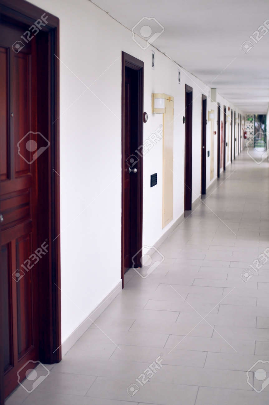 long corridor with many doors located on outdoor veranda in a cheap hotel Stock Photo - & Long Corridor With Many Doors Located On Outdoor Veranda In A ...