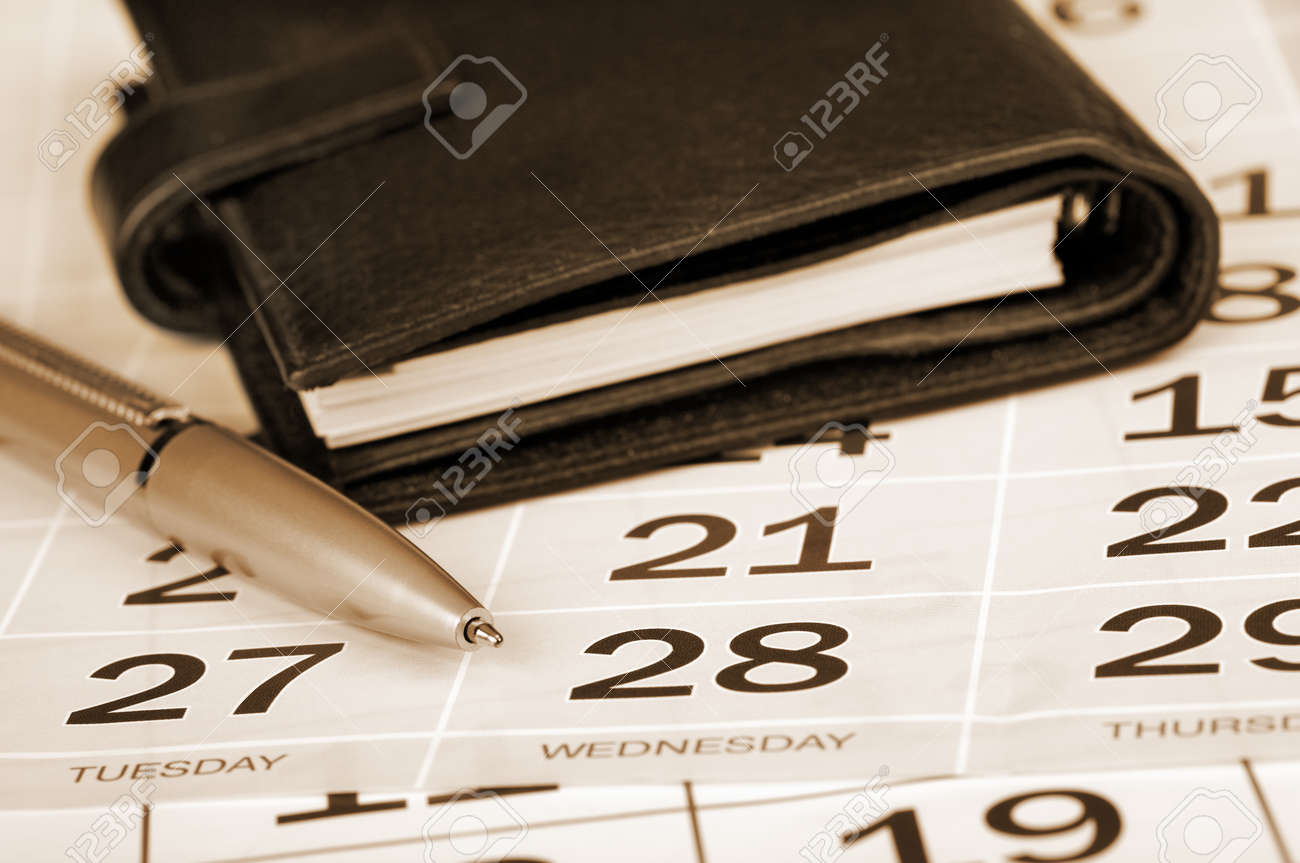 Calendar page, pen and pocket planner Stock Photo - 14985478