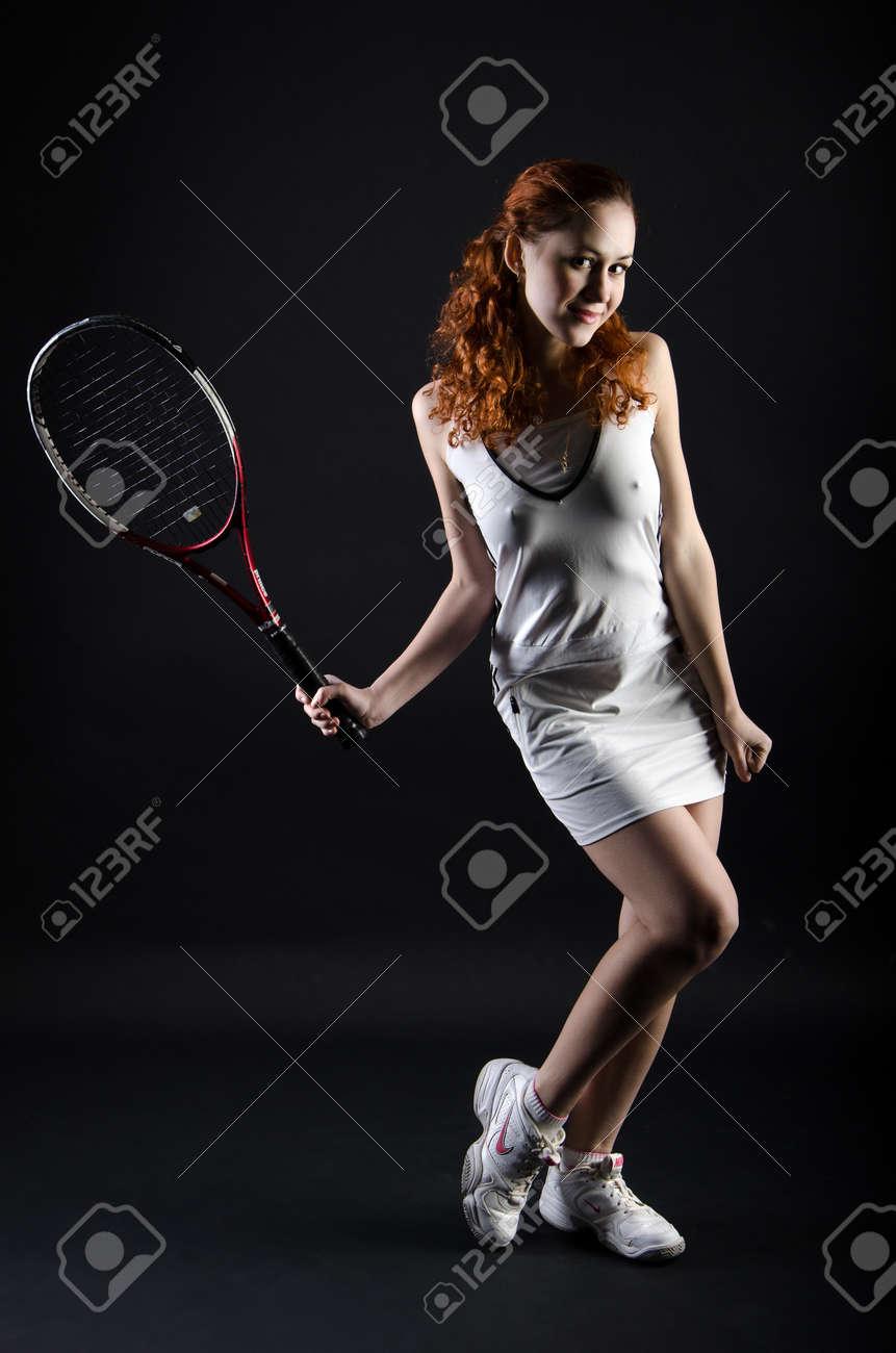 Tennis girl on dark background Stock Photo - 14826804