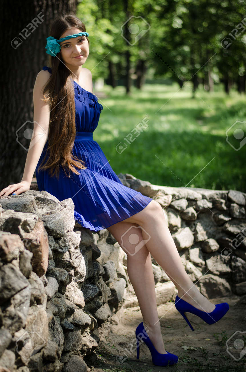 Prom Girl In Blue Dress On Rock Fence Stock Photo Picture And ...