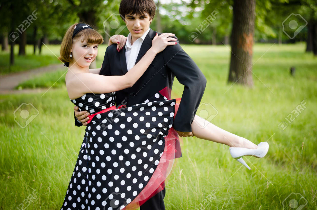 Young teen couple after the prom in a park. Stock Photo - 17544672