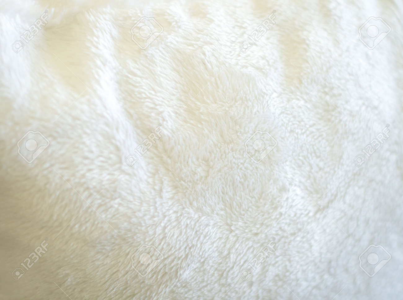 luxurious wool texture from white sheepskin rug stock photo