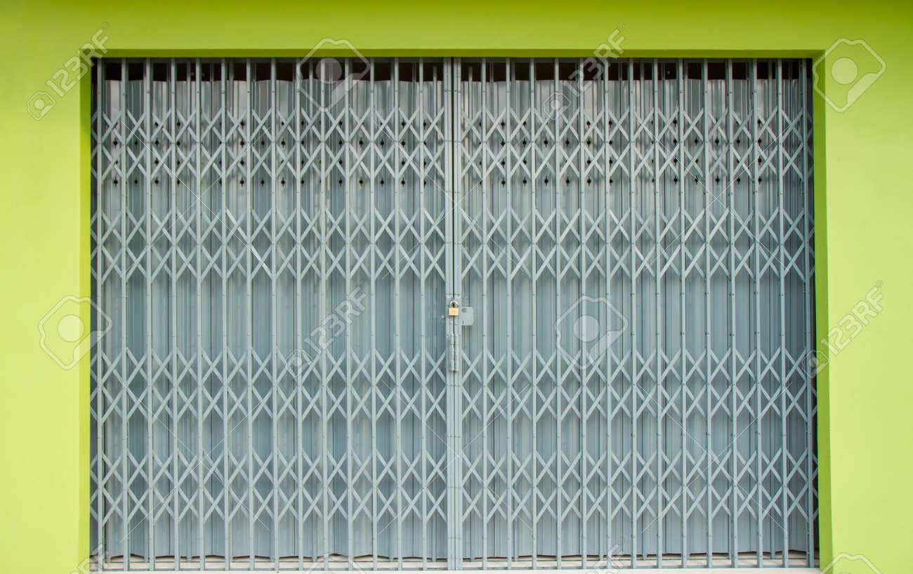 Antique slide steel locked shutter door, texture background Stock Photo -  40389415 - Antique Slide Steel Locked Shutter Door, Texture Background Stock
