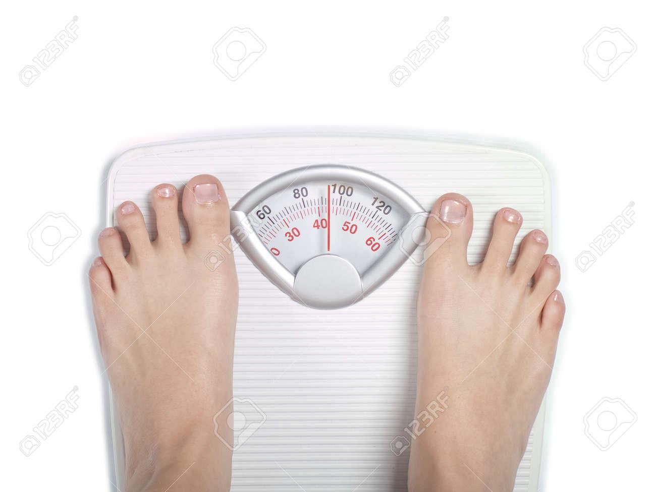 Feet on diet bathroom scale Stock Photo - 14334939