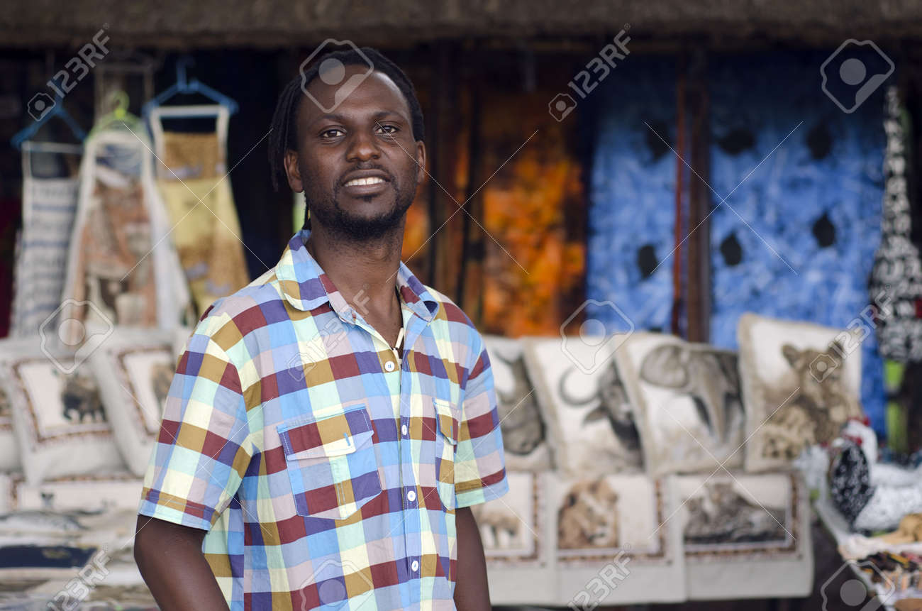 African small business curio salesman selling ethnic items in Howick, KwaZulu-Natal South Africa Stock Photo - 16406324