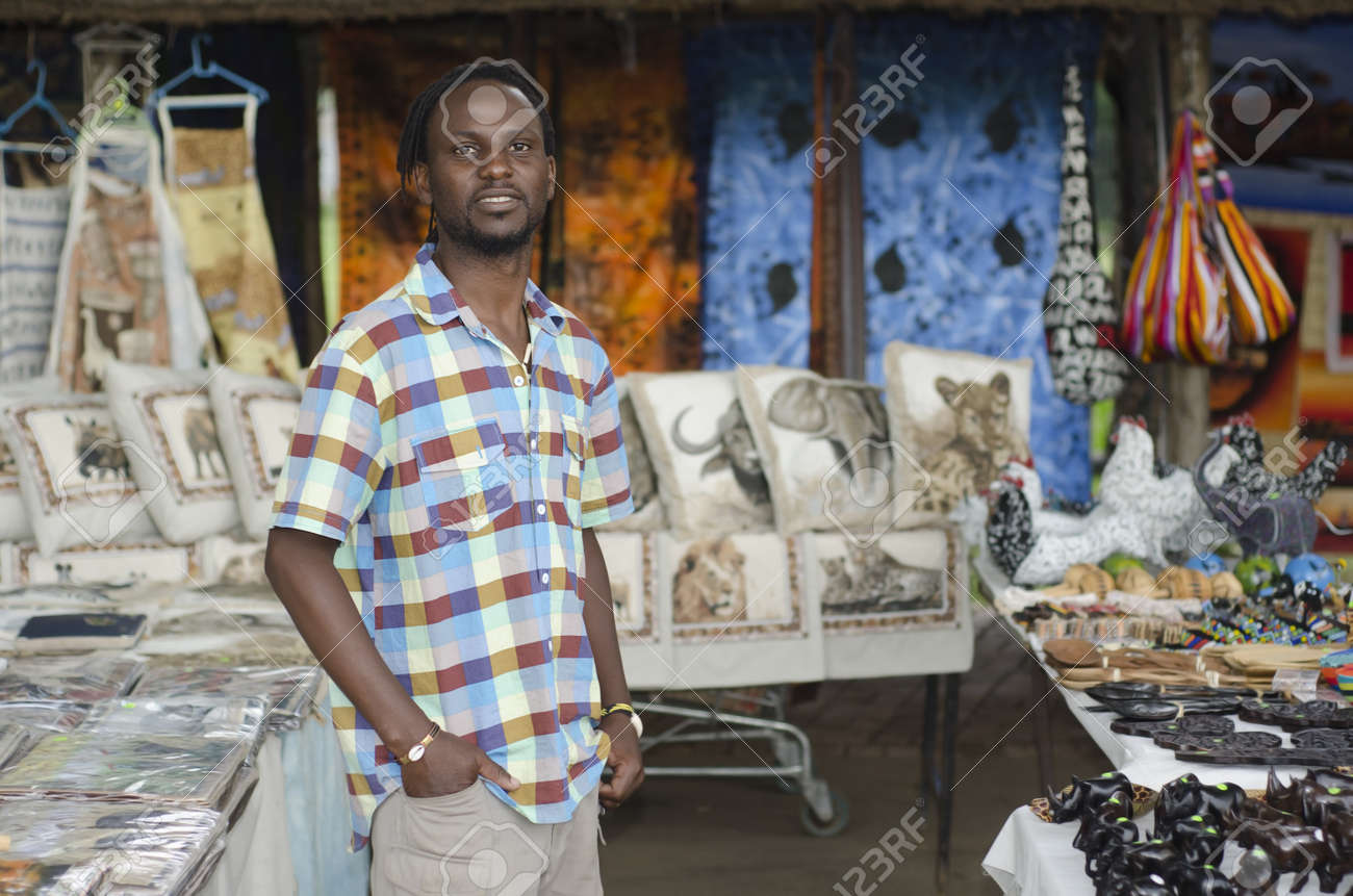 African small business curio salesman selling ethnic items in Howick, KwaZulu-Natal South Africa Stock Photo - 16406325