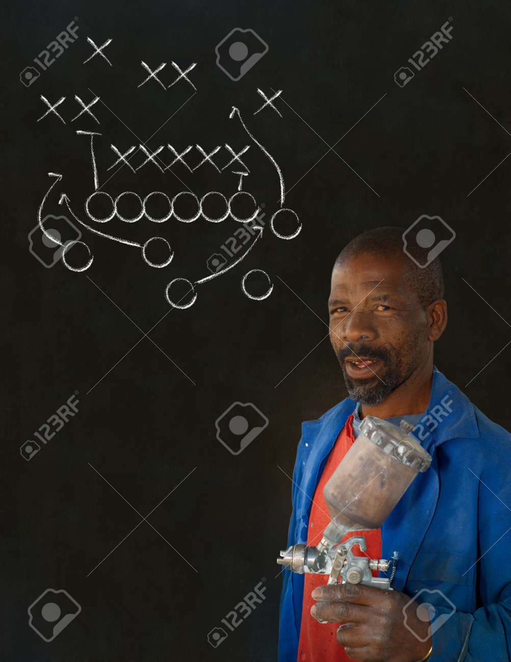 African American black man industrial worker with chalk game plan on a blackboard background Stock Photo - 22841911