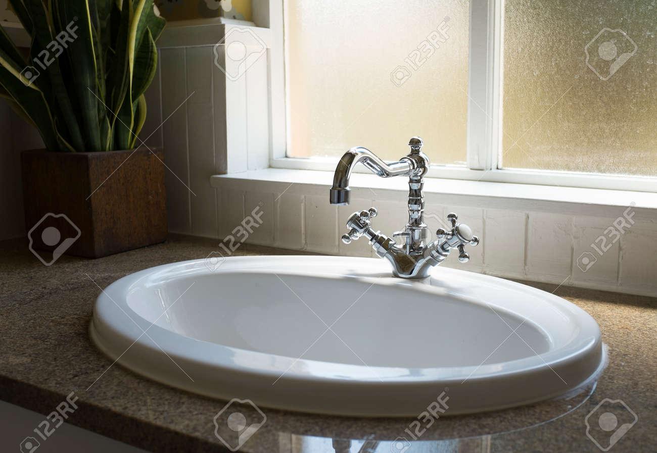 Old Retro Water Tap Basin In Modern Bathroom Toilet With Window - Modern-bathroom-toilet
