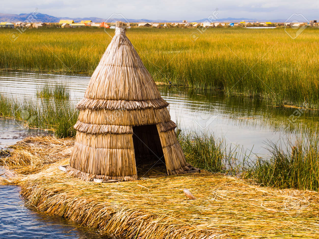 Primitive Reed Hut On Lake Titicaca In The Reed Islands Of Peru
