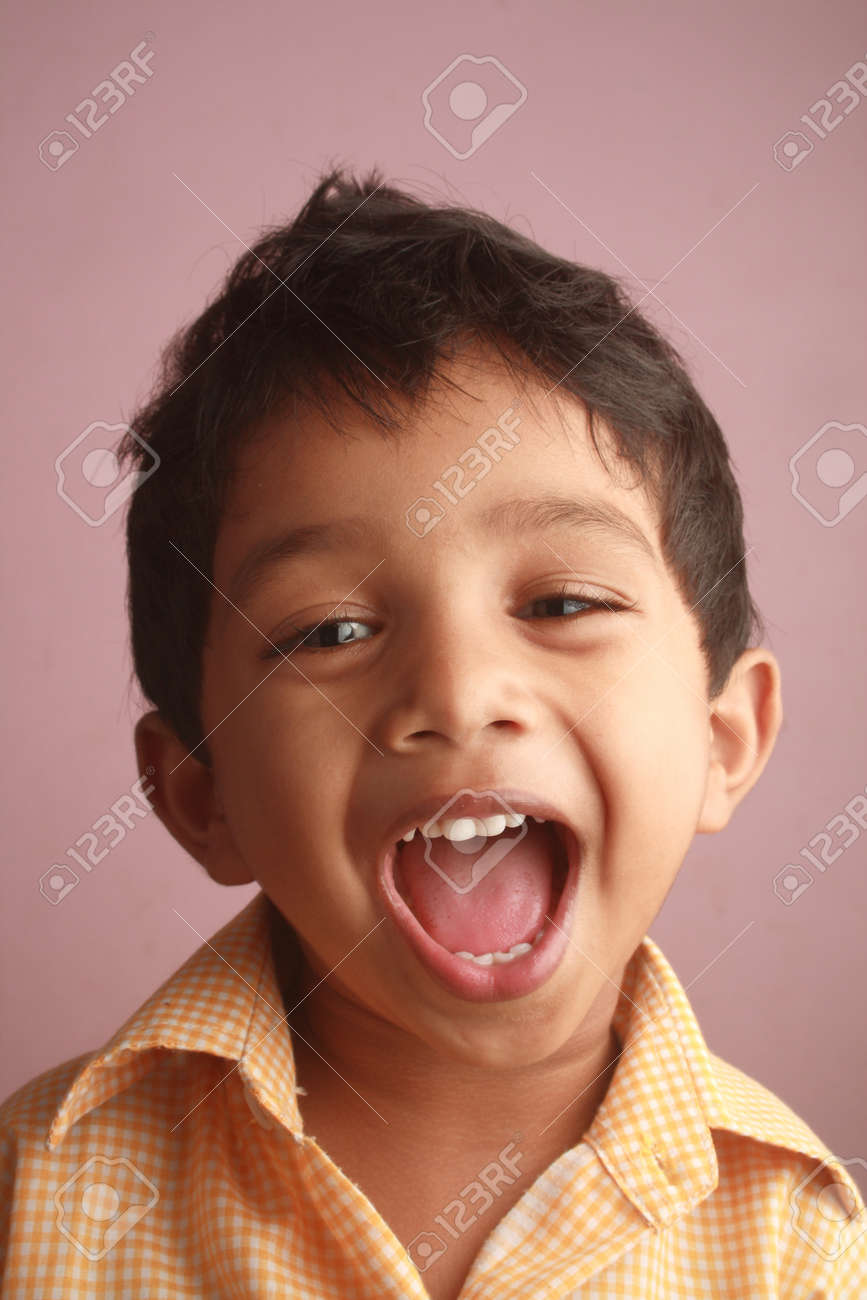 an indian boy screaming stock photo picture and royalty free image