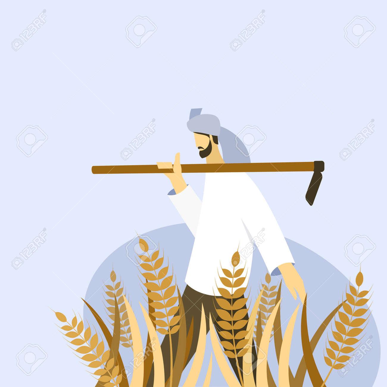 A farmer holding a spade walks through a wheat farm - 170582370