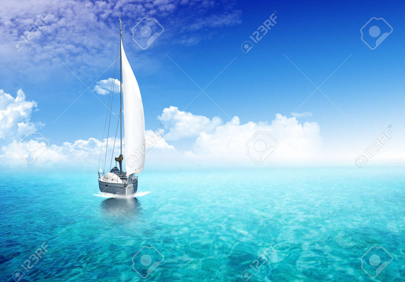 Sailing boat in the ocean with sunlight in the backgroiund - 12658308
