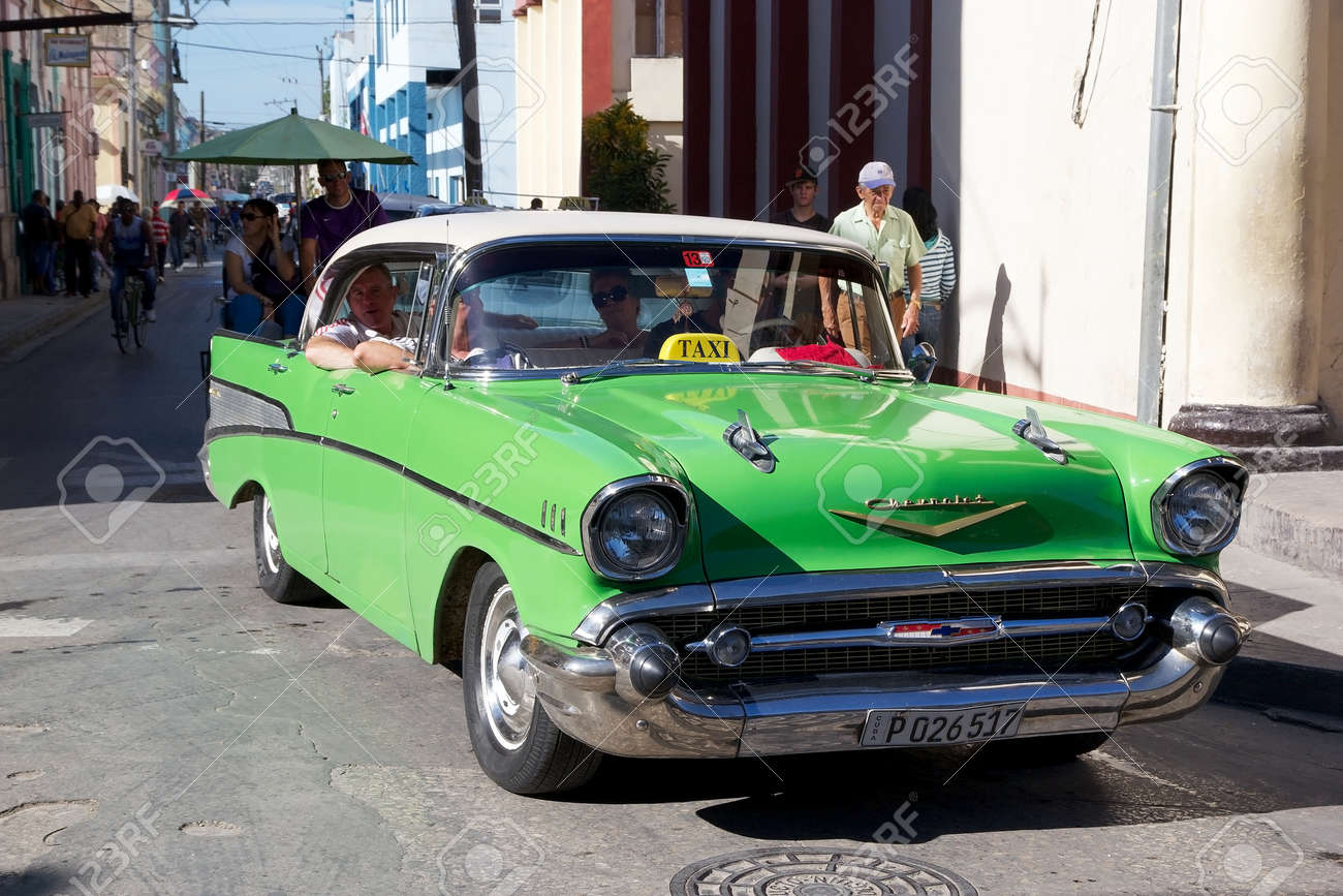 Cuban Man Is Driving The Old American Classic Car Used As Taxi ...