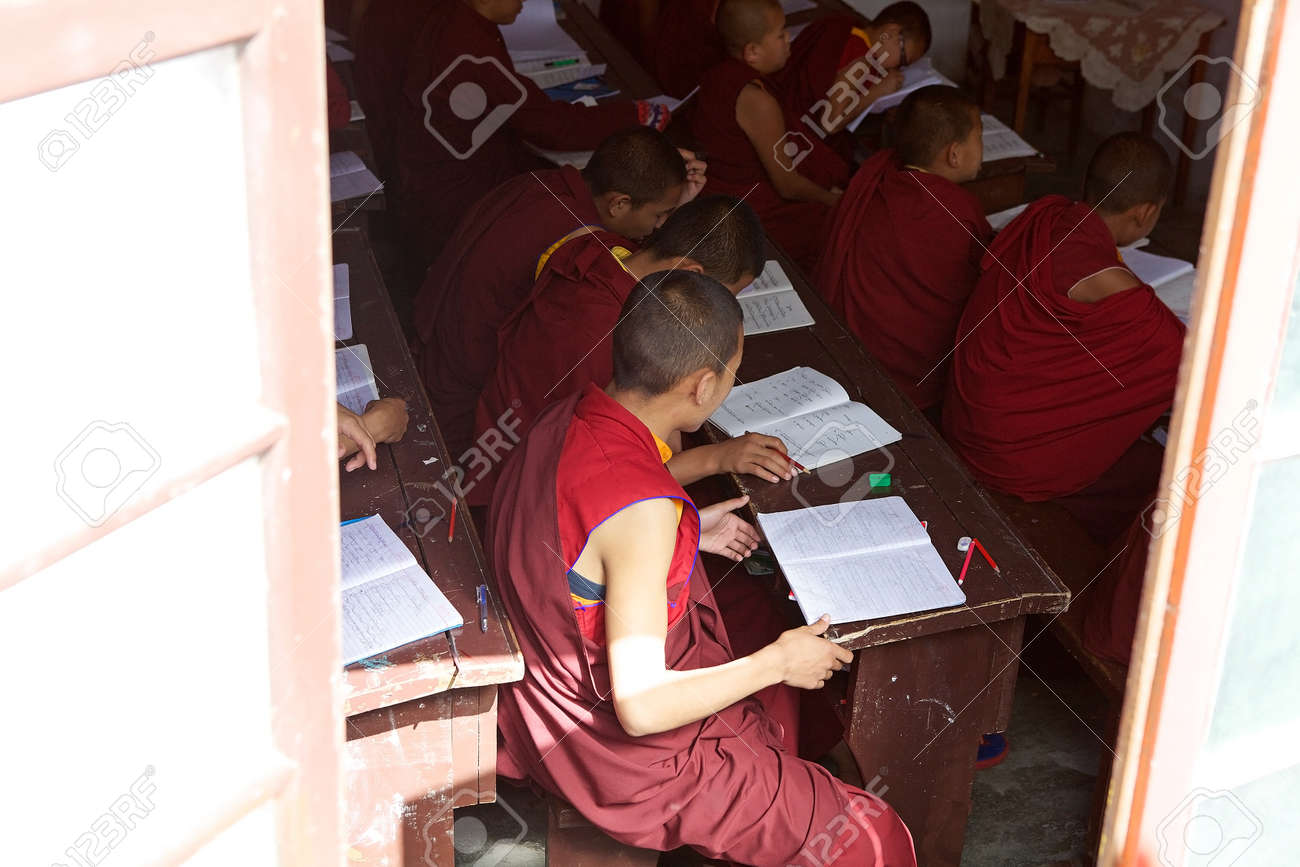 Buddhist Monks In Traditional Robes Are Studying In The Classroom