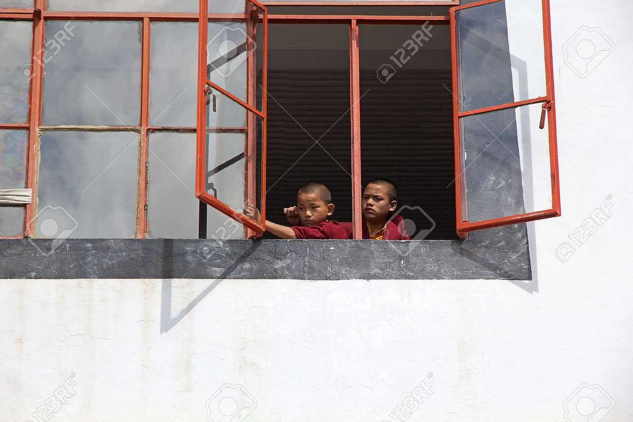 Young Monks In Traditional Robes At The Window At The Dali Monastery