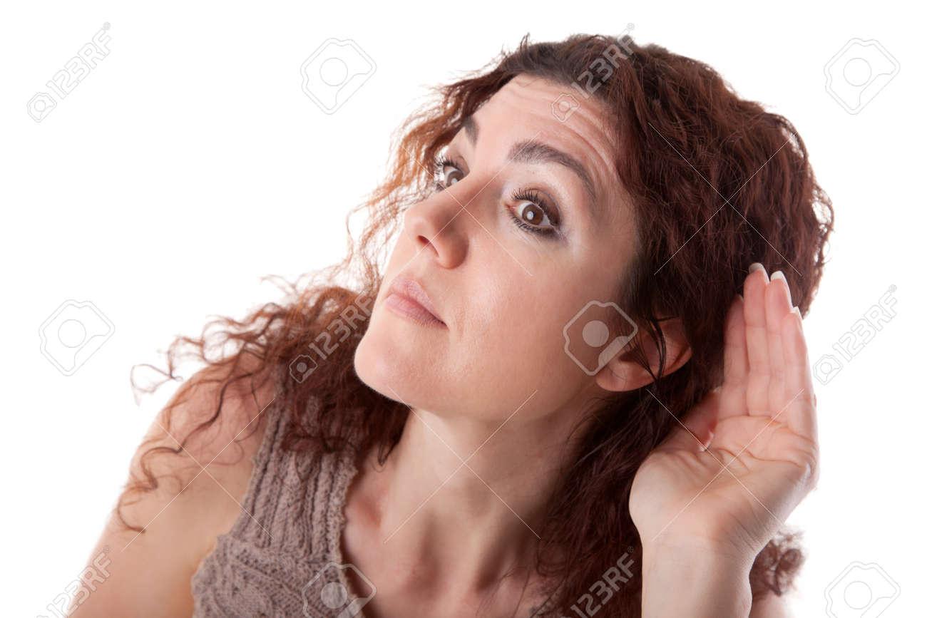 Beautiful brunette, listening. Studio shot on white background. Stock Photo - 14390079