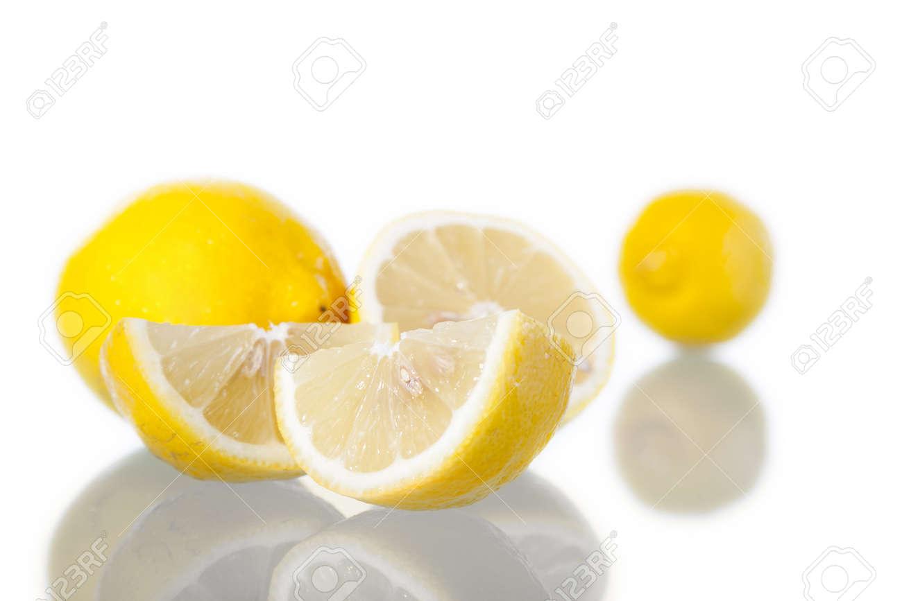 Lemons in white background, with reflection. Studio shot. Stock Photo - 14411854