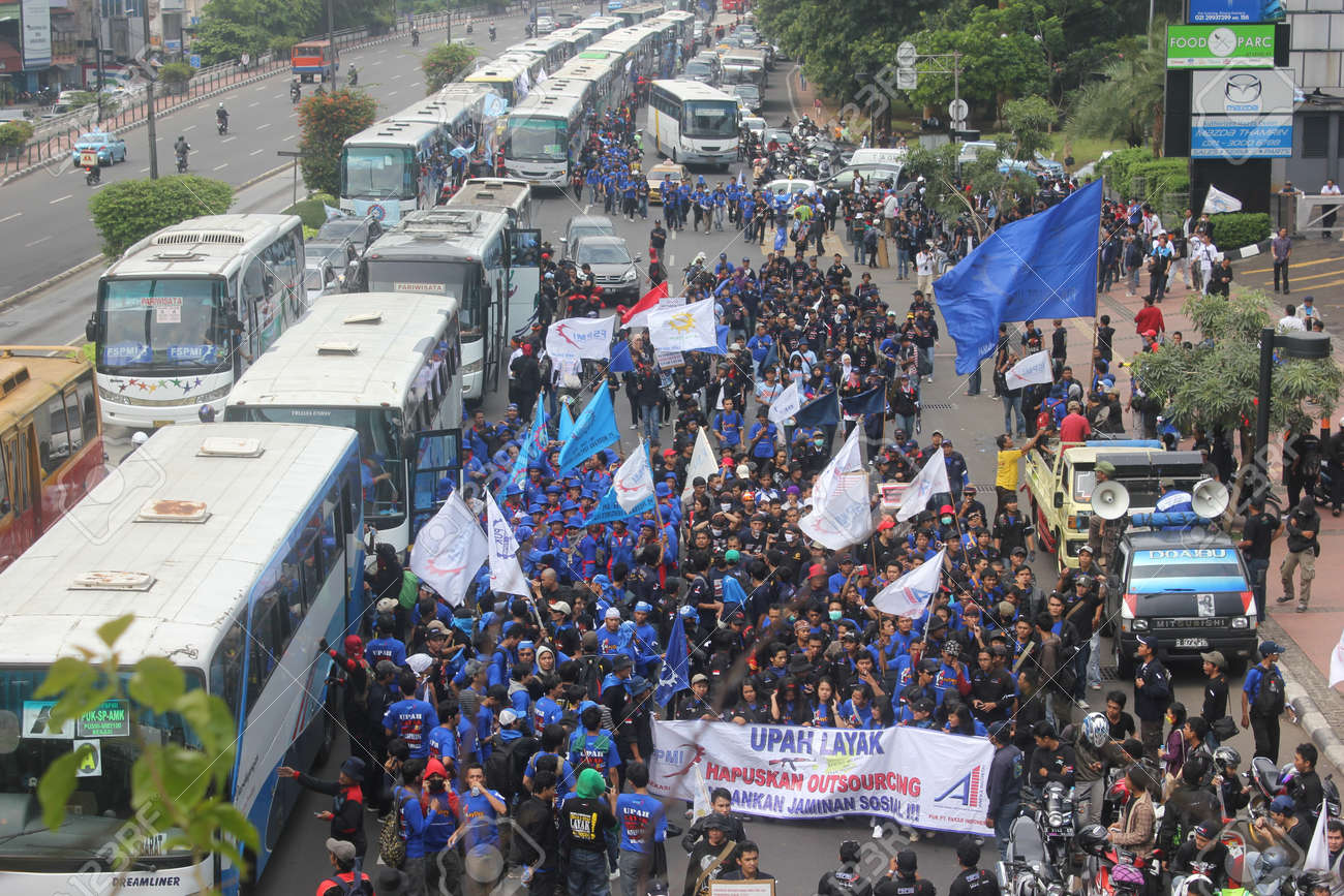 Jakarta, Indonesia, 1 May 2012. Thousands Indonesian workers held rally in Labor Day, demanding better wages and eliminated outsourcing. Stock Photo - 13491594