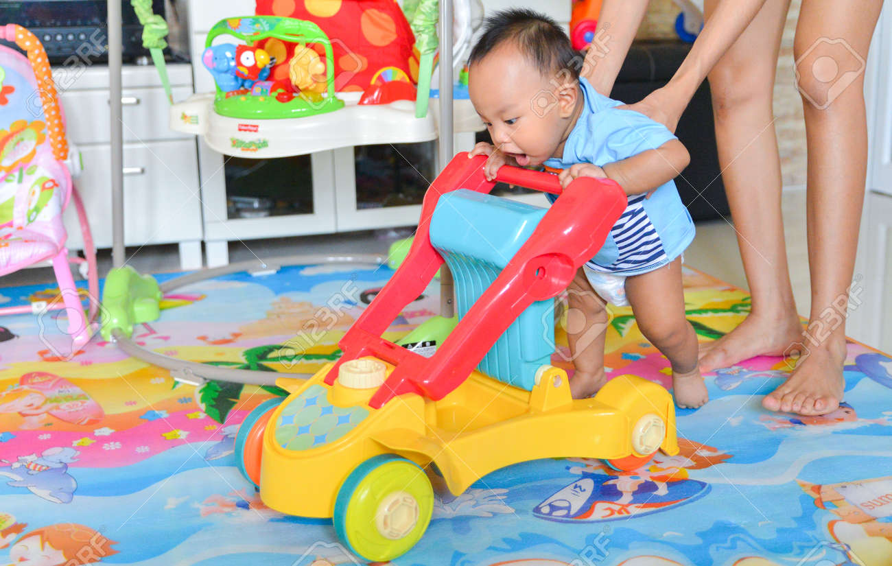 Asian baby boy playing Baby Walker, Baby toy - 134720333