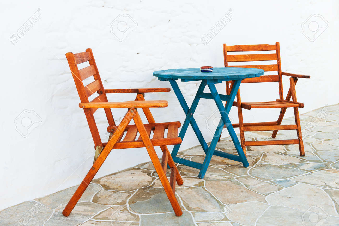 Colorful wooden chair and table arrangement from a Greek island alleyway Stock Photo - 15059117