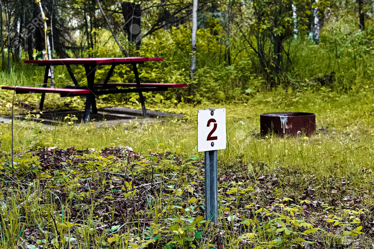 Camping Site Marker With A Picnic Table And Fire Pit In The - Fire picnic table