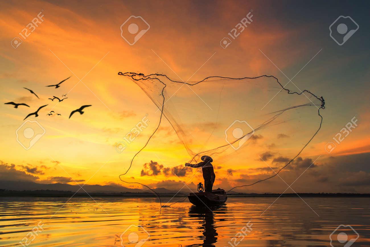 Fisherman fishing at lake in Morning, Thailand. - 47265871
