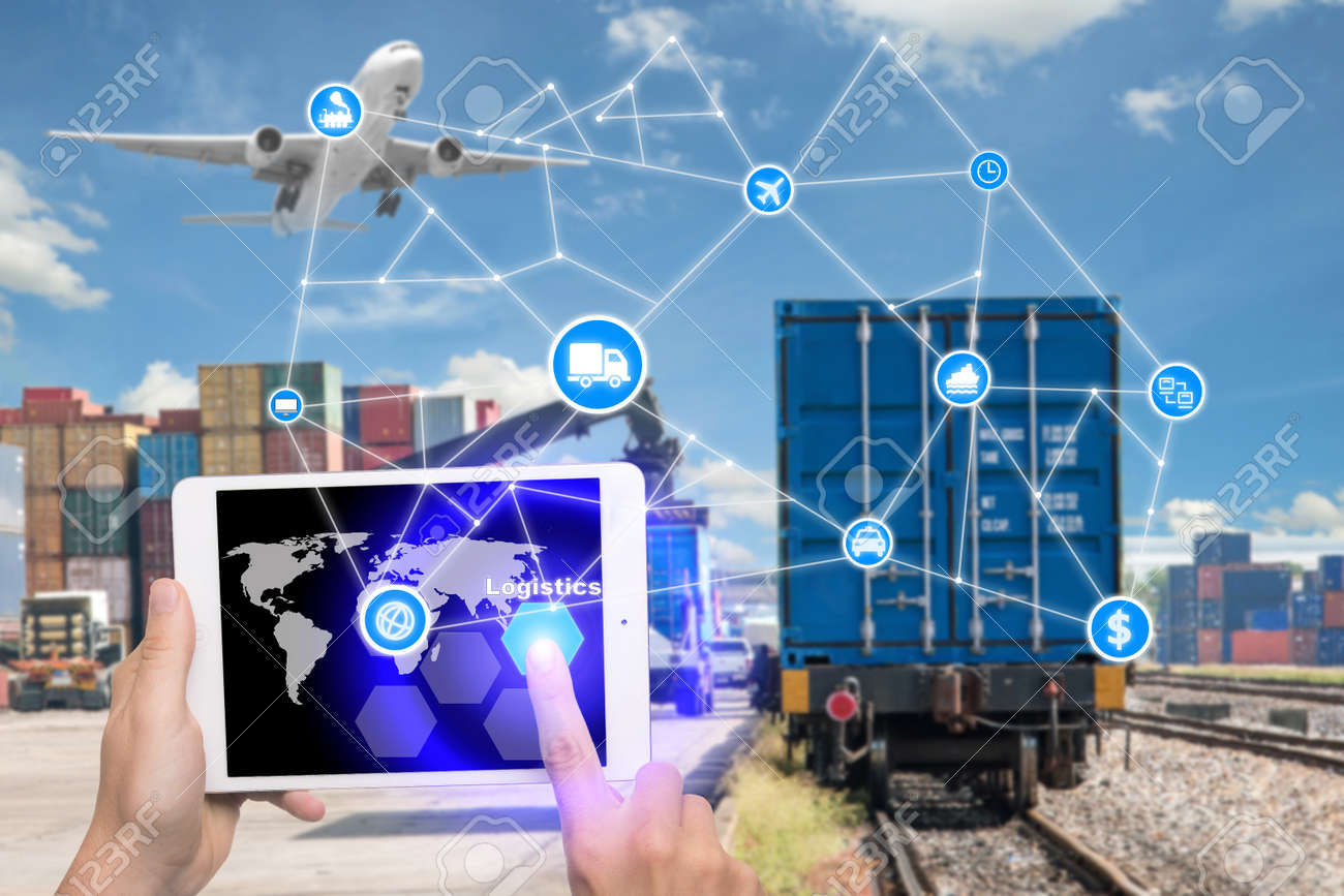 Hand holding tablet is pressing button Logistics connection technology interface global partner connection for logistic import export background. Business logistics concept , internet of things - 70275467
