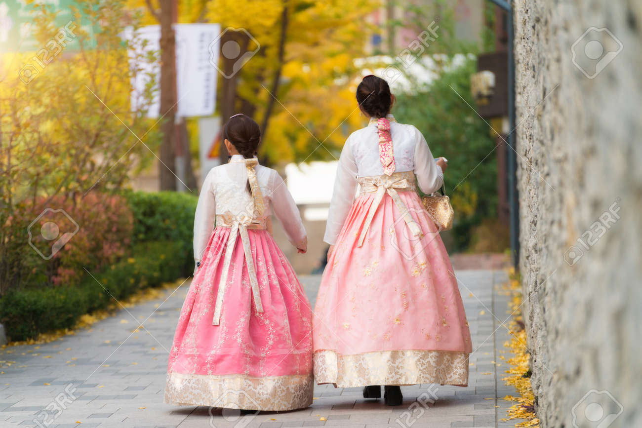 Asian Korean Woman Dressed Hanbok In Traditional Dress Walking