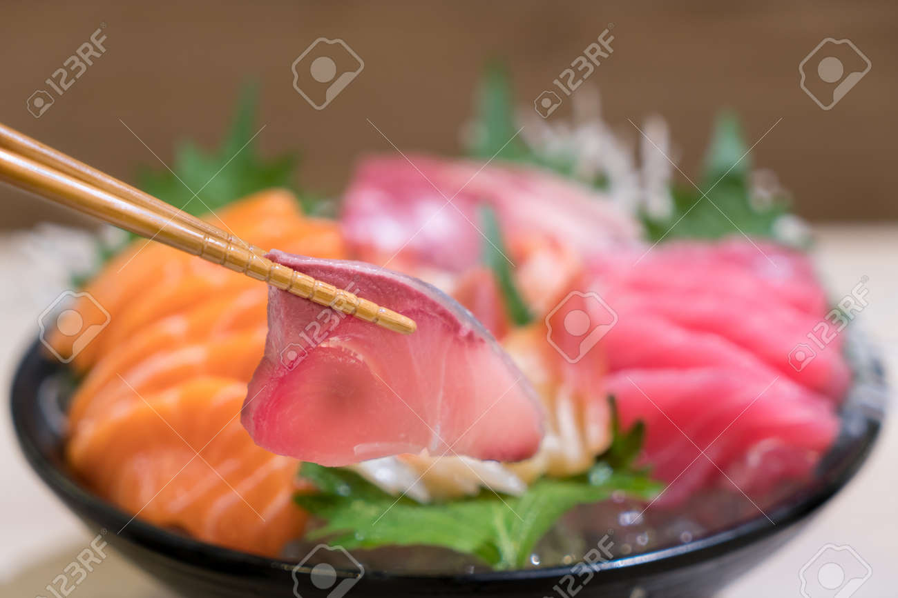 Chopsticks With Hamachi Sashimi With Mixed Sliced Fish Sashimi