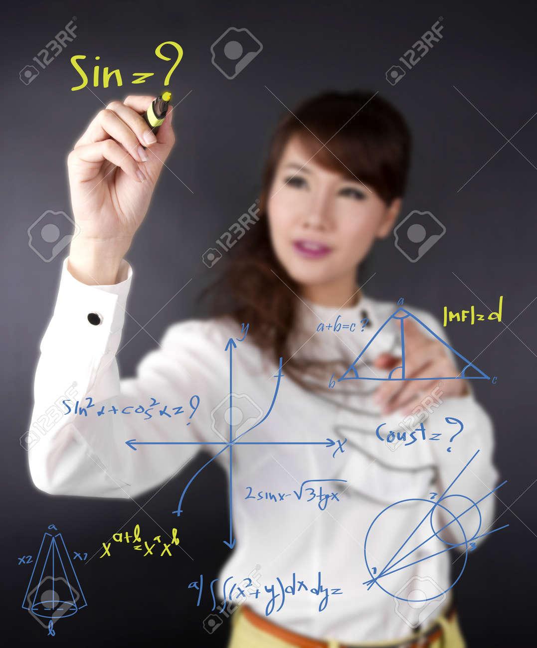 write math chart, Asian female writing mathematics calculation on wall Stock Photo - 15261783