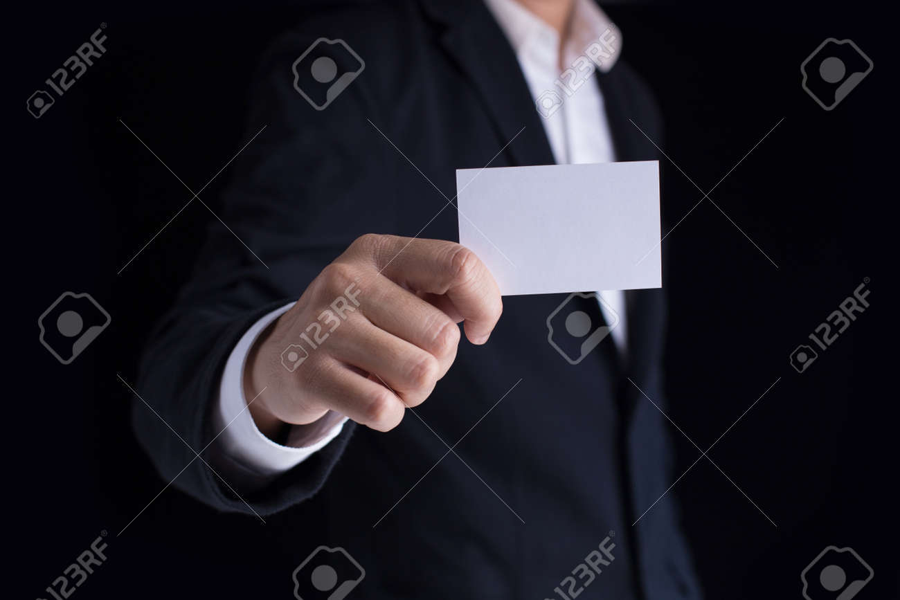 A Man In Business Black Suit Holding A White Blank Business Card ...