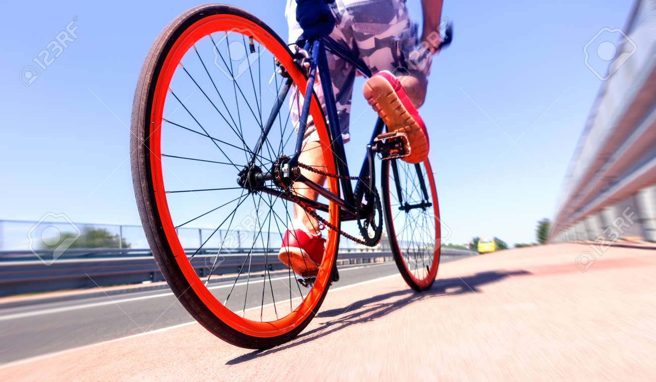 Man Cycling On Sport Bike Bicycle Wheels And Road Perspective