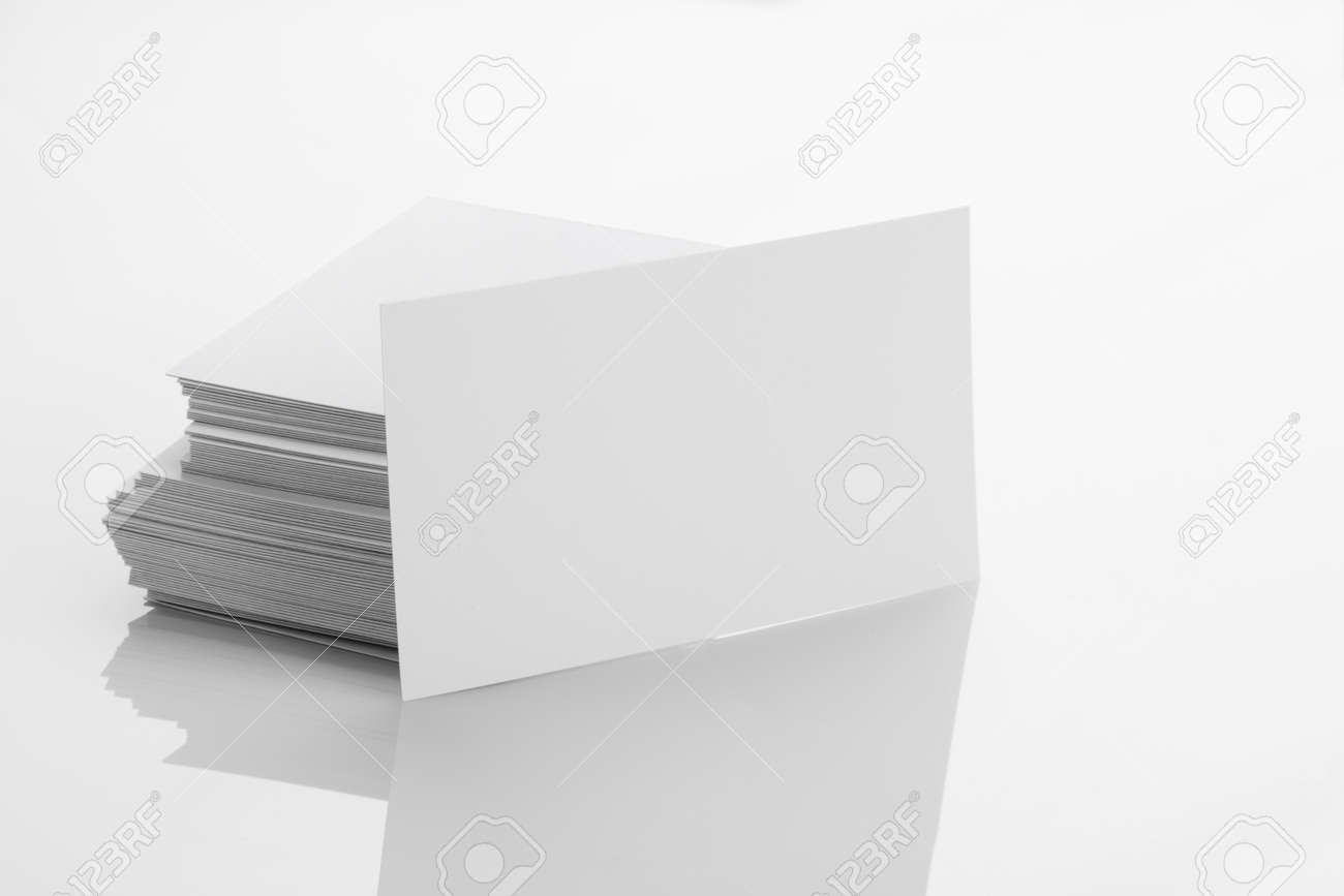 Blank business card mockup on white reflective background stock blank business card mockup on white reflective background stock photo 37618937 reheart Choice Image