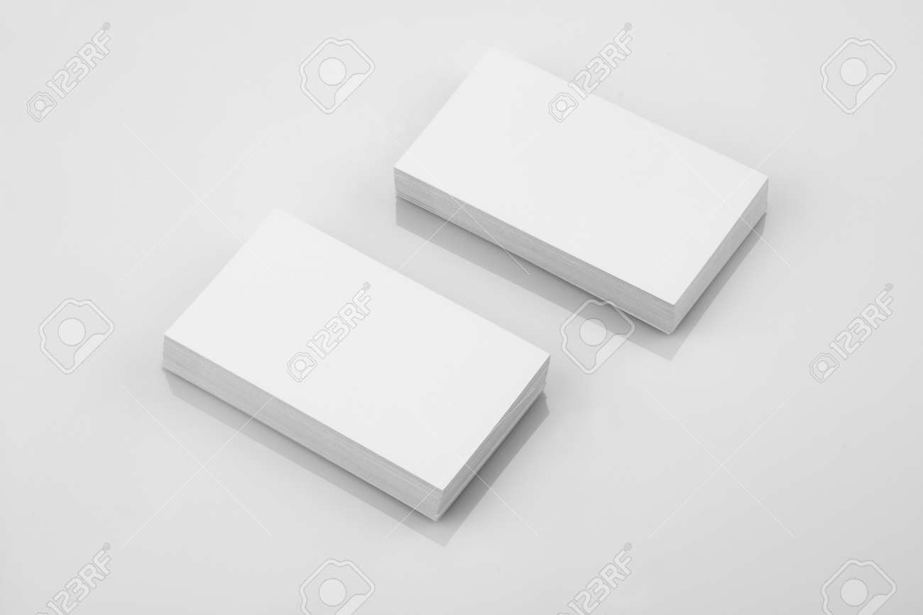 Blank business card mockup on white reflective background stock blank business card mockup on white reflective background stock photo 57940128 reheart Choice Image