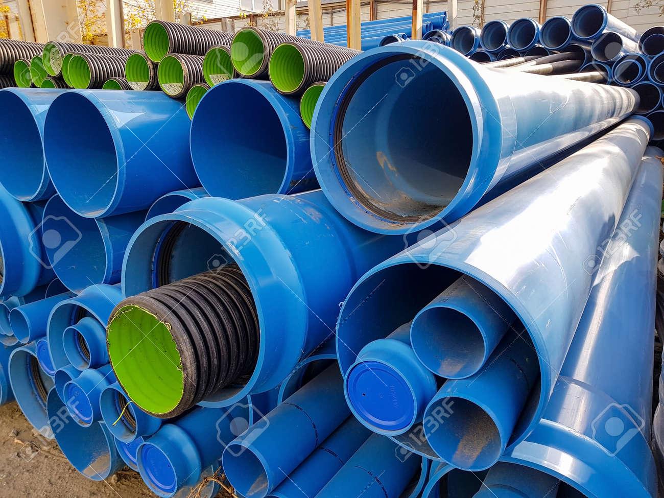 Blue PVC tubes in storage, Plastic tubes, Background of PVC - 136805223