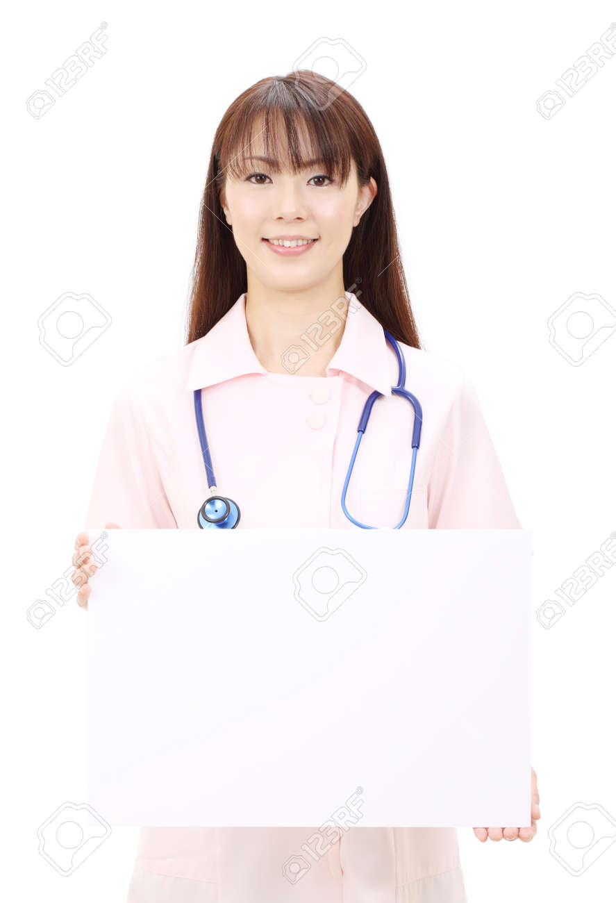 Young asian female nurse holding a blank white board Stock Photo - 12052583