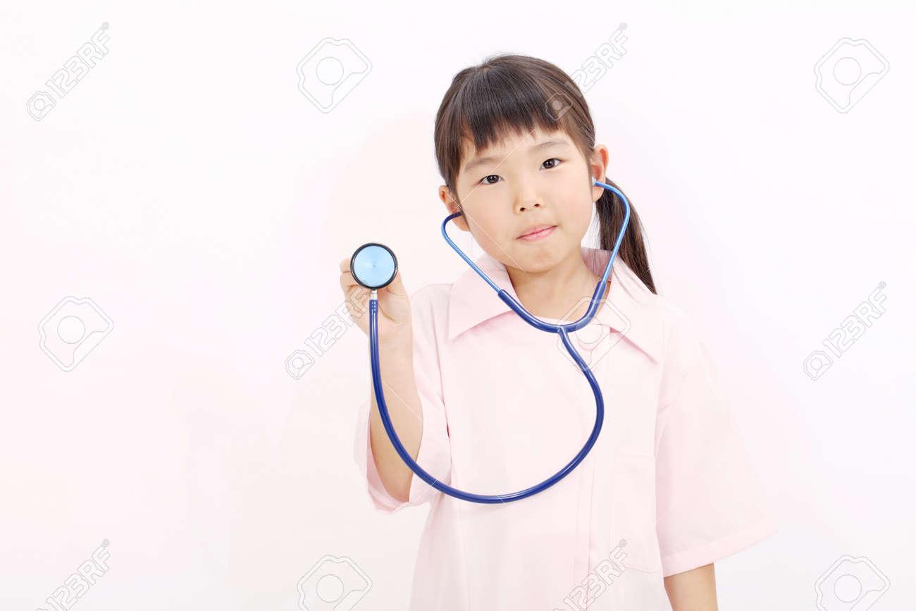 594c592d77c Shot of a little girl in a nurse uniform