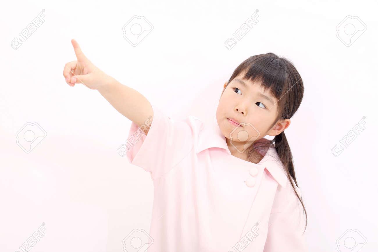 8769345adf3 Portrait of happy little girl nurse pointing