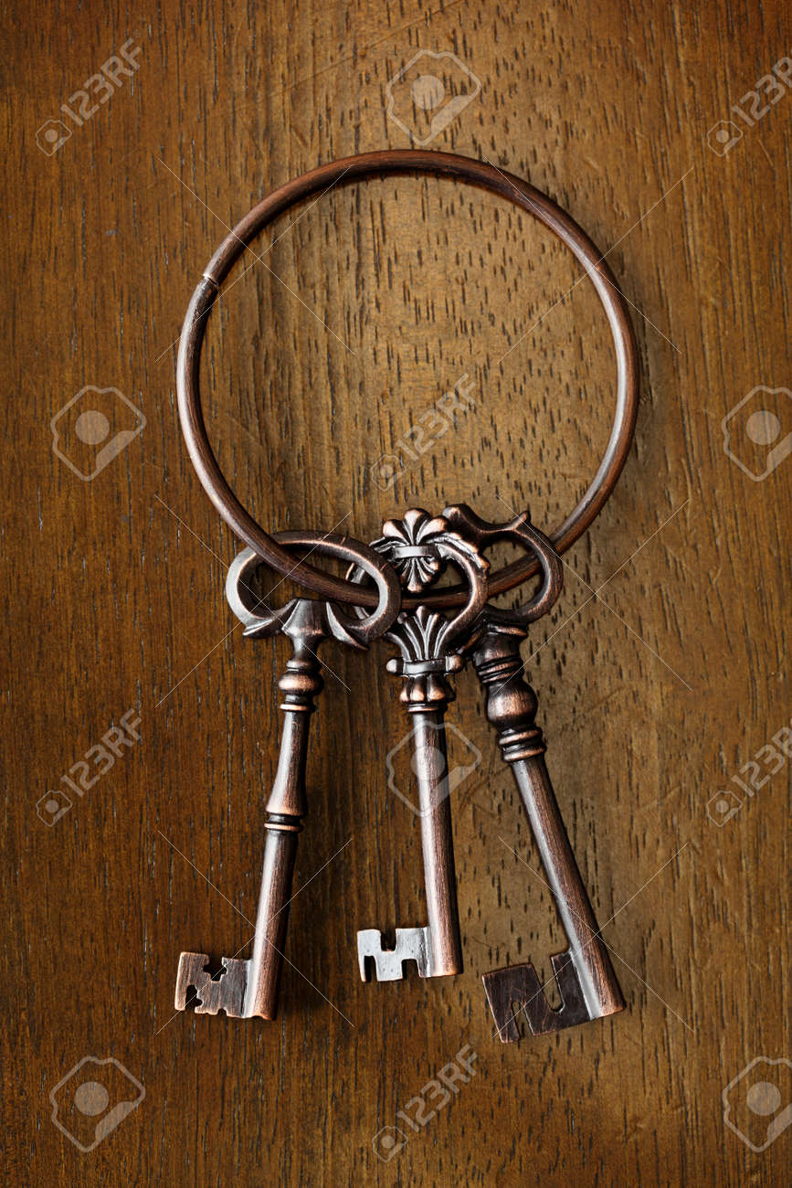 Antique key on wooden background Stock Photo - 13586886
