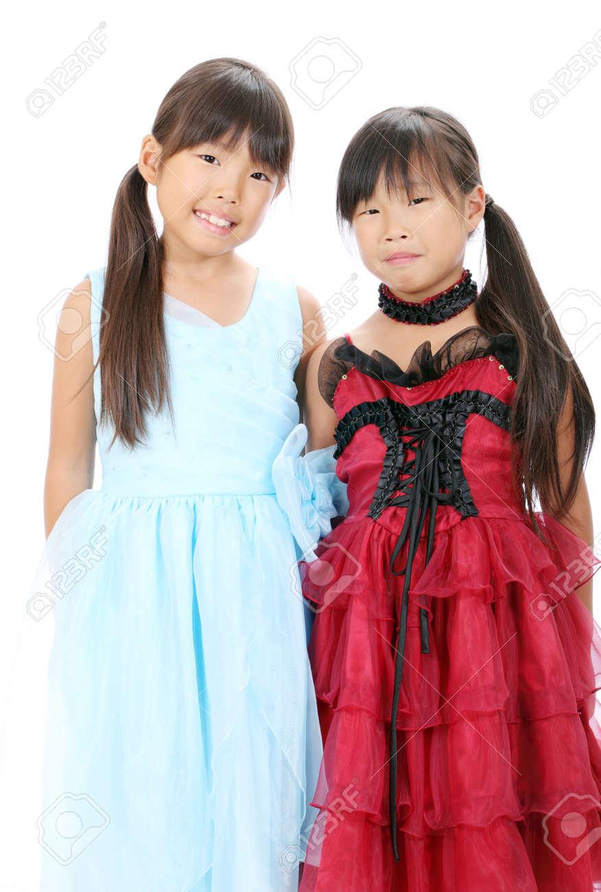 Two little asian girls wearing dress Stock Photo - 16334283