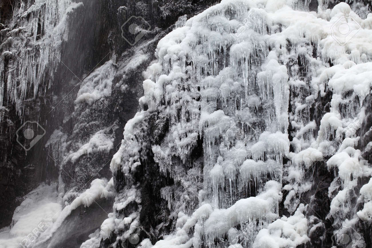 Waterfall on a mountain river in winter Stock Photo - 17459120