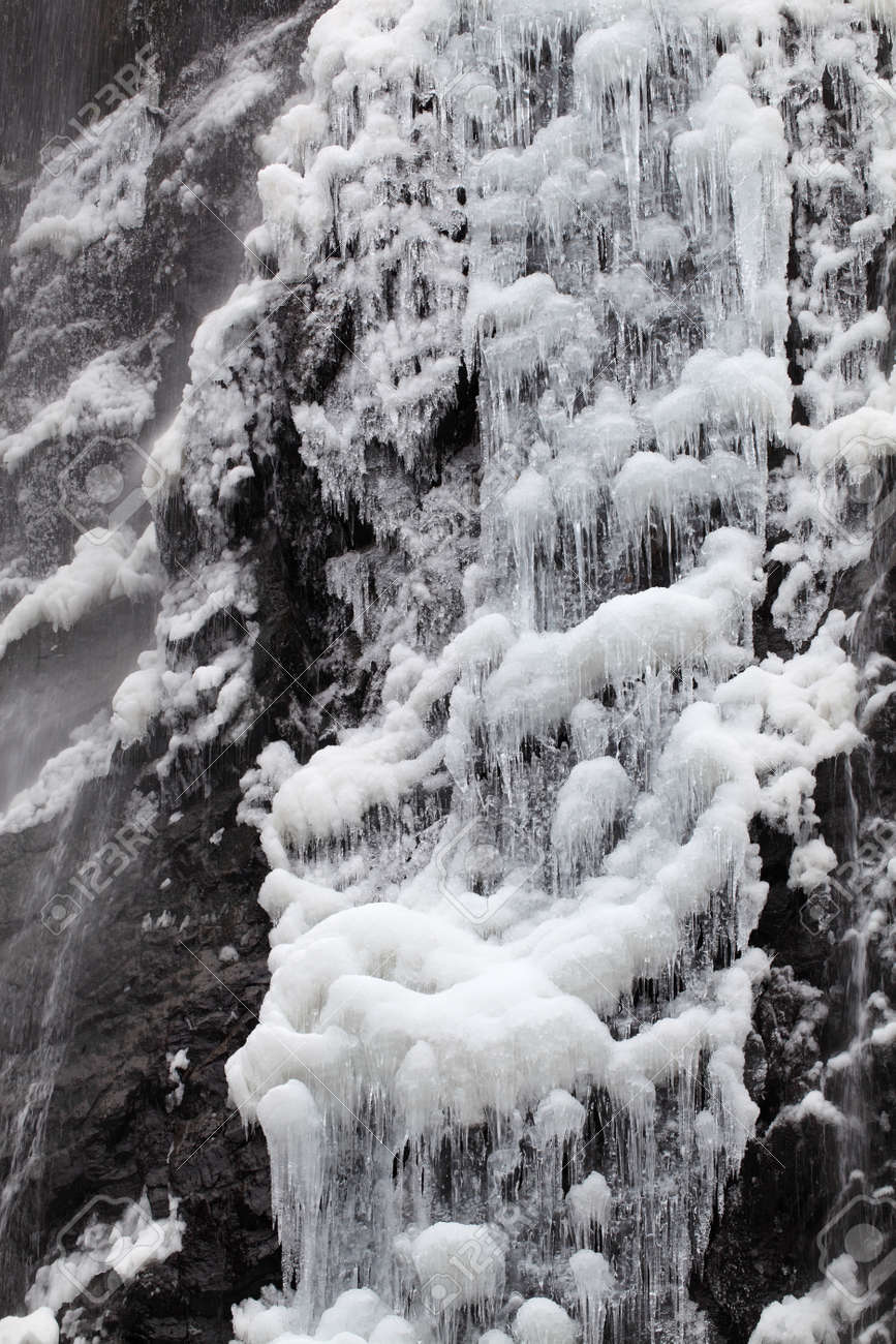 Waterfall on a mountain river in winter Stock Photo - 17459116